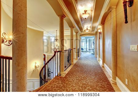 Elegant Hallway With Black Railing.