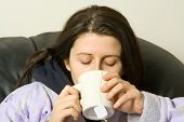 woman with a cold drinking a hot tea poster