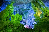 The beautifully illuminated Reed Flute Caves located in Guilin Guangxi Provine China poster