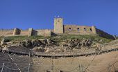 Roman theatre and Medellin castle Spain. Low view from stage to grandstand poster