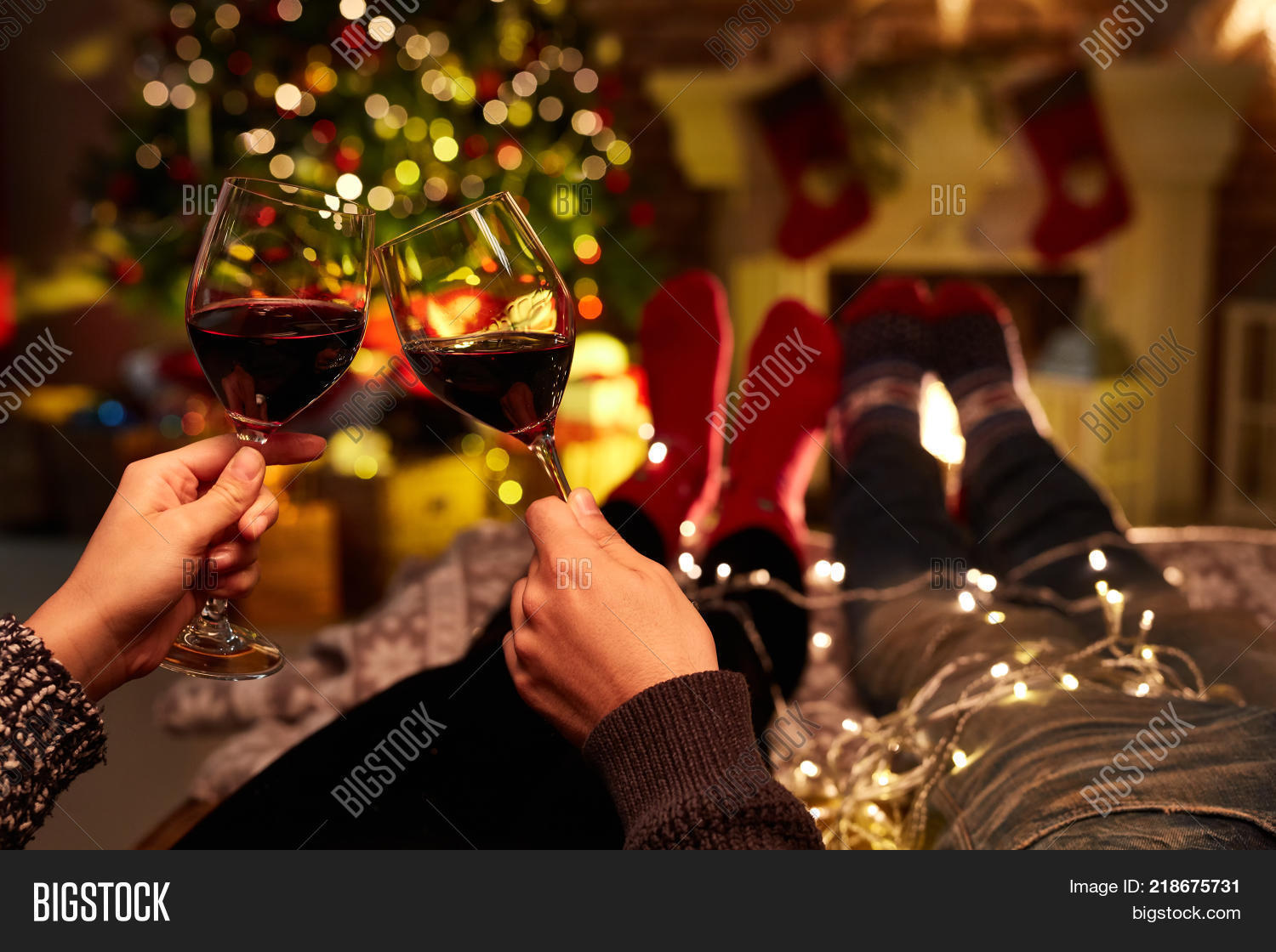 christmas couple at home in winter couple drinking red wine at home in christmas time