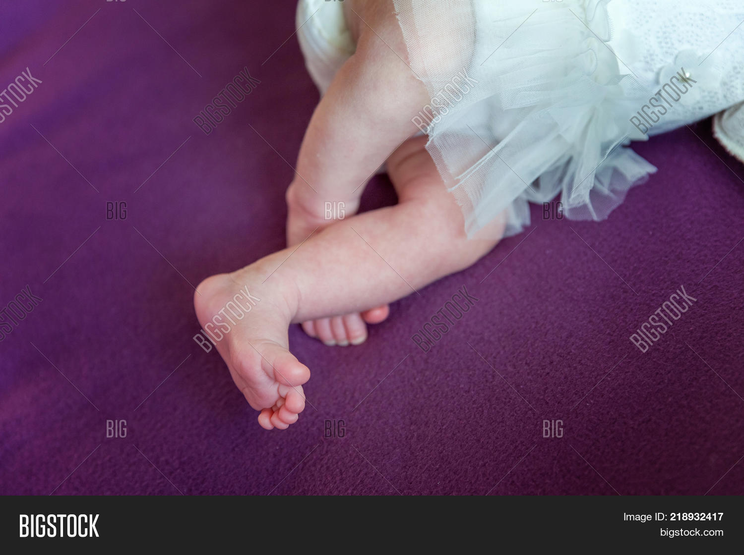 Soft newborn baby feet against a white blanket tiny newborn babys feet closeup happy