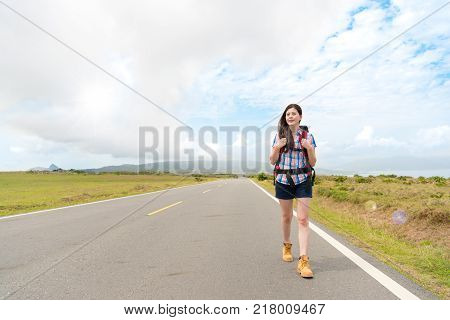 Woman Carrying Baggage Backpack On Roadside