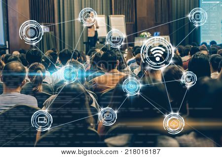 Wireless communication connecting of smart city Internet of Things Technology over Abstract blurred photo of conference hall or seminar room with attendee background technology with education concept, 3D illustration