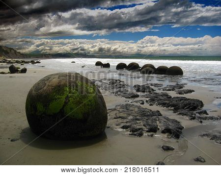The Moeraki Boulders in New Zealand are unusually large and spherical rocks