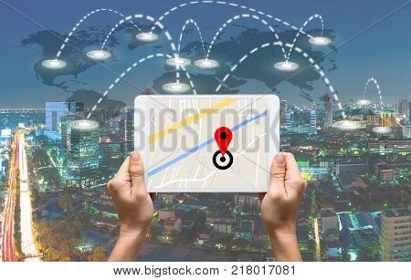 female hands holding a tablet showing part of navigator map over the tablet screen on connection line over the world map with cityscape Navigation conceptElements of this image furnished , 3D illustration