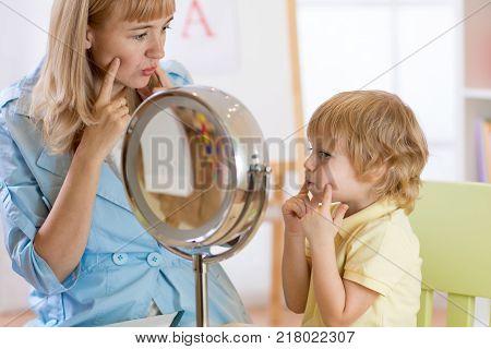 Child preschooler boy at speech therapist office