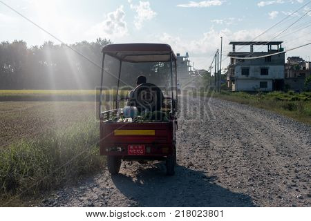Man carries vegetables on his tuk tuk car, Nepal
