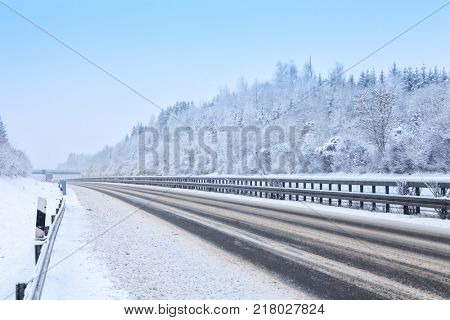 Highway during a snowfall in winter,  Bavaria,  Germany.