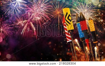 Abstract colored firework background with rockets. Free space for text. Celebration and anniversary concept