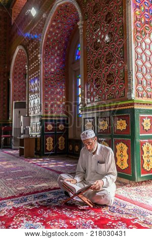 Srinagar, India - June 15, 2017: Kashmiri man praying in Masjid Dastgeer Sahib mosque in Srinagar, Kashmir, India
