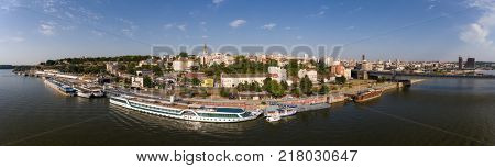 Aerial panorama Belgrade cityscape from Sava river in Serbia at summer evening