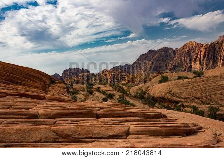 The red mountains and petrified sand dunes of Snow Canyon State Park in Southern Utah.