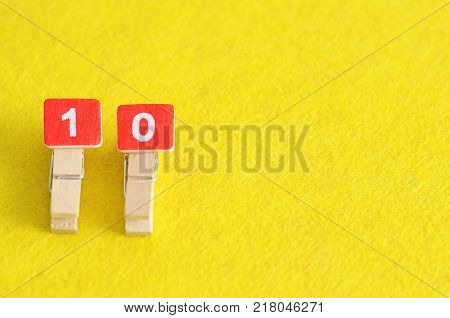 Number 10 in white numbers displayed on a yellow background