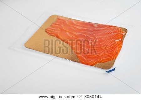 Fillet of red vacuum-packed fish isolated on white background
