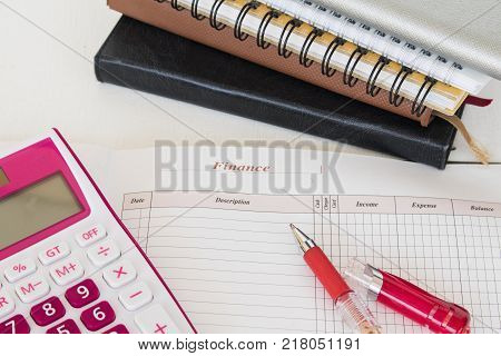 notebook memorandum and calculator for work business on table white