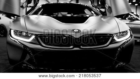 Sankt-Petersburg Russia July 21 2017: Luxury BMW i8 hybrid electric coupe. Plug-in hybrid sport car. Concept electric vehicle. Black and white. Car exterior details. Photo Taken at Royal Auto Show July 21