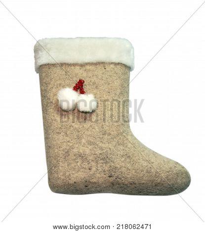 Child's valenki - russian felt footwear, isolated over white background