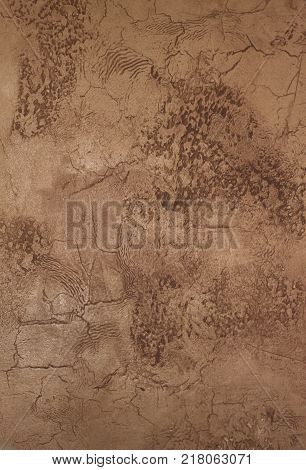 Faux painted and textured beige stucco wall