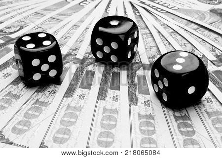 Poker dice rolls on a dollar bills Money. Poker table at the casino. Poker game concept. Playing a game with dice. Casino dice rolls. Concept for business risk. chance good luck. Black and white