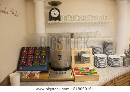 Hot pot and many flavor tea in pack for people making tea for drink in restaurant room at resort hotel at Pfunds in morning time on September 2 2017 in Tyrol Austria