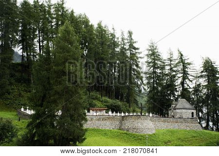 Tomb or Graves at Campanile di curon venosta vecchia or Submerged tower of reschensee church deep in Resias Lake at Trentino-Alto valley in South Tyr or Alto Adige in Bolzano or bozen city at Italy