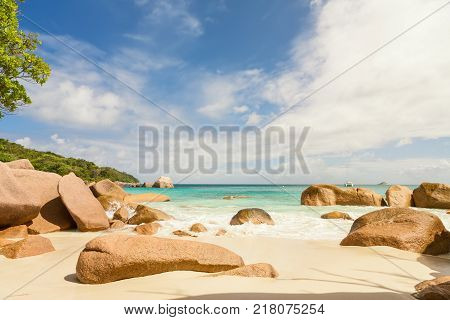 Sandy tropical beach of La Digue island Seychelles with typical granite boulders in turquoise ocean