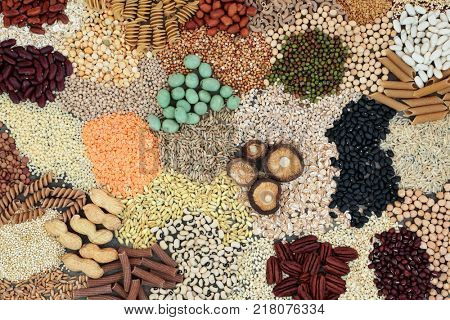 Macrobiotic diet food background with cereals, grains, legumes, seeds, wasabi and monkey nuts, whole wheat pasta and vegetables with foods high in fiber, antioxidants and minerals. Top view.