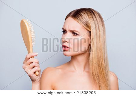 Concept Of Hair Loss. Close Up Portrait Of Unhappy Sad Stressed Young Woman With Long Dry Blonde Hai