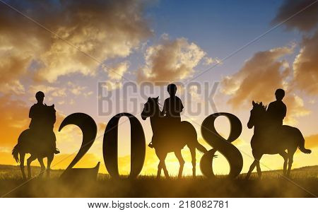 Silhouette of a womans riding a horse at sunset. Forward to the New Year 2018.