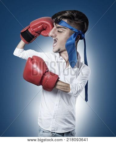 caricature of funny businessman with red boxing gloves and blue tie as headband showing biceps