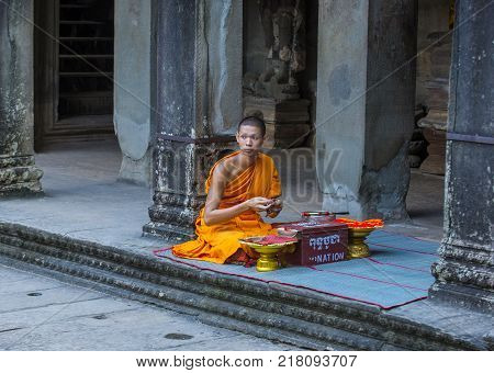 Siem Reap Cambodia - Oct 17 : Budhist Monk At The Angkor Wat Temple In Siem Reap Cambodia On October