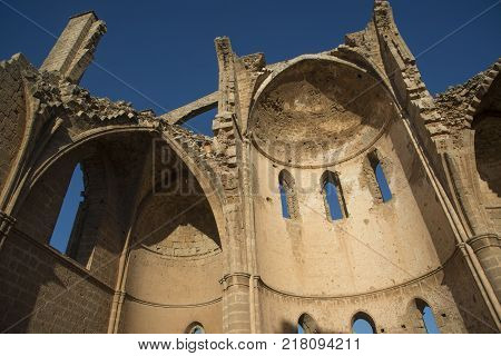Arch of old Christianity church (St. George of the Greeks ) in Famagusta. Northern Cyprus. Blue sky in background.