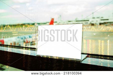 Mock up white Label on table for blank menu frame in restaurant in ariport Stand for acrylic tent card Used for Menu Bar blur of light background insert for text of customer.