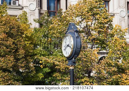 Bucharest Romania October 10 2017 : Large clock with arrows on the Boulevard Unirii in Capital city of Romania - Bucharest