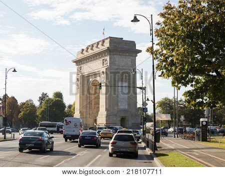 Bucharest Romania October 10 2017 : The Arch Of Triumph - 26m granite arch built in memory of WWI troops with internal stairs for city views щт еру Arc de Triomphe Square in Bucharest city in Romania