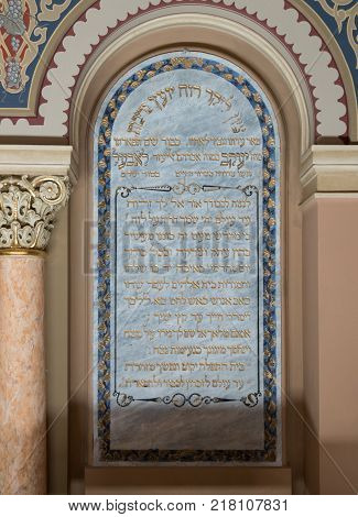 Bucharest Romania October 10 2017 : Memorial plaque with an inscription in Hebrew on the wall in the synagogue Coral in Bucharest city in Romania