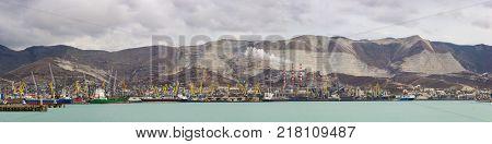 Russia Novorossiysk - October 28.2017: Panorama of Novorossiysk cargo port and Smoking chimneys of a cement plant of JSC