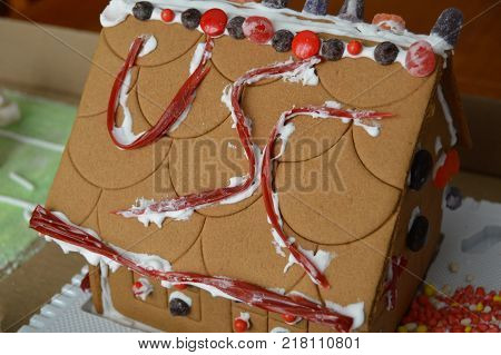 USC on roof of gingerbread decorated house