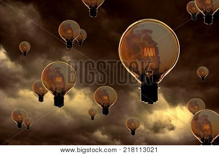 GLASS ELECTRIC LIGHT BULB WITH GLOWING FILAMENT CONTAINING IMAGE OF POWER STATION COOLING TOWERS FLOATING IN STORMY SKY