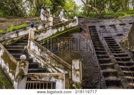 An old staircase and an ancient rocky staircase in Buddhist rock temple in Mulkirigala, Sri Lanka