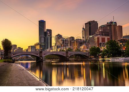 MELBOURNE, VICTORIA,  AUSTRALIA - JANUARY 28, 2017 : Sunset over skyscrapers of Melbourne downtown, Princess Bridge and Yarra River. Long exposure