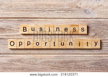 Business opportunity word written on wood block. Business opportunity text on table concept.