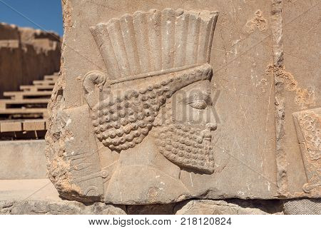 Ruined portrait of persian man with beard. Relief on wall of abandoned city Persepolis, capital of Achaemenid Empire 550 - 330 BC