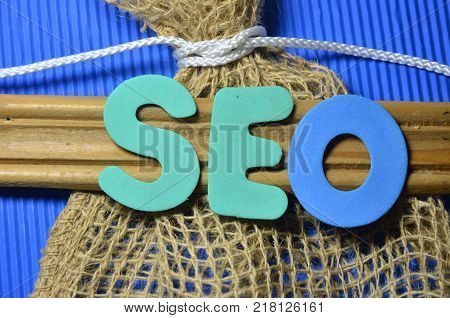 WORD SEO ON AN   ABSTRACT BLUE BACKGROUND