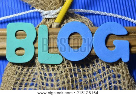 WORD BLOG ON AN ABSTRACT BLUE BACKGROUND