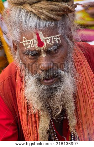 KOLKATA WEST BENGAL INDIA - JANUARY 10 TH 2015 : Portrait of an old Indian Sadhu with saffron dress and white beard on face.