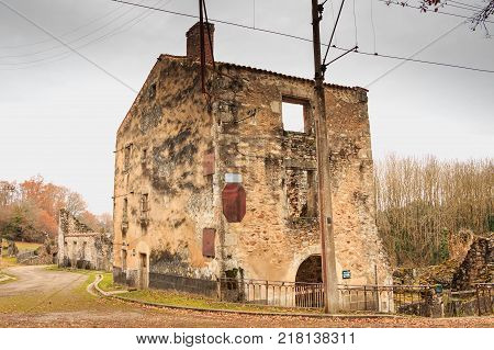 ORADOUR SUR GLANE FRANCE - December 03 2017 : in the village streets remains in ruins of houses destroyed by fires during the massacre of the population by the German army at the end of World War II