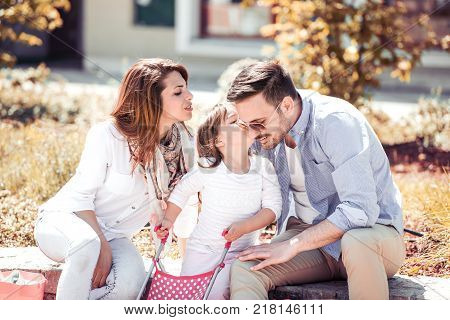 Happiness and harmony in family life.Happy family concept.Happy family resting together in the city.Family having fun outdoor.
