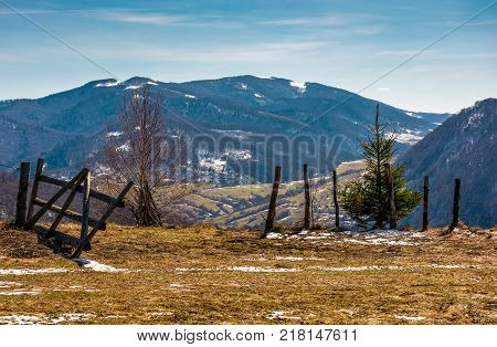 wooden fence on the edge of a hillside. beautiful countryside springtime landscape in mountains
